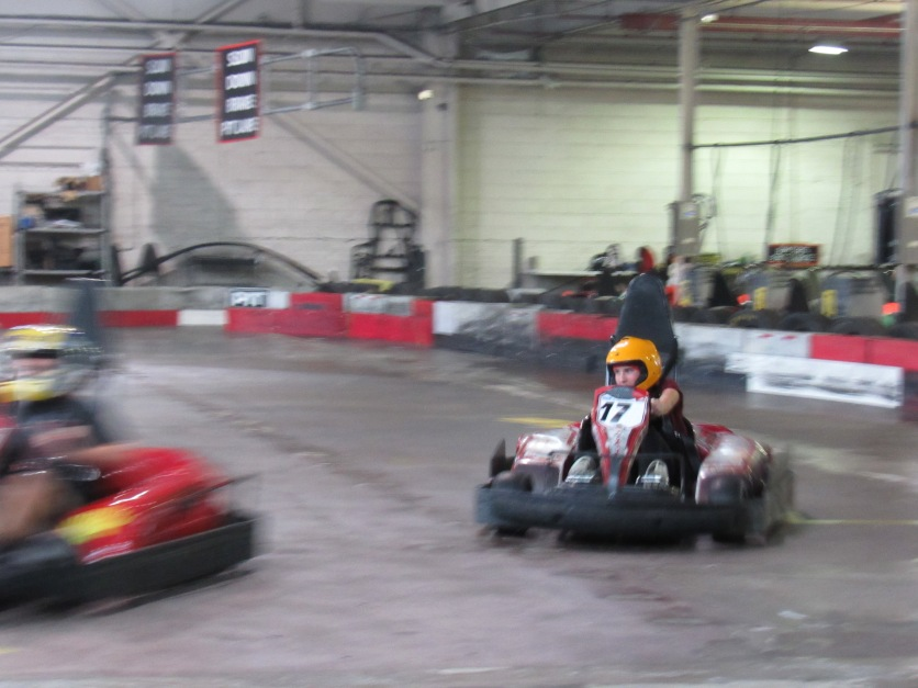 Sophia muscles the kart around the track.