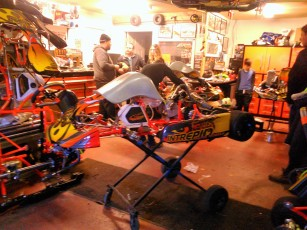 Assembling the kart with a Briggs & Stratton engine.
